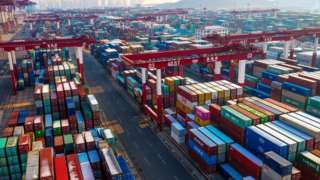 Containers are seen stacked at a port in Qingdao in China's eastern Shandong province.