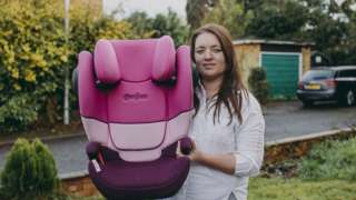Kayleigh Powell, pictured with one of her child car seats