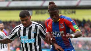 DeAndre Yedlin and Wilfried Zaha