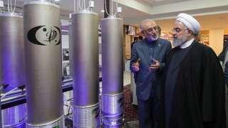 Iranian President Hassan Rouhani (R) and the head of Iran nuclear technology organization Ali Akbar Salehi inspecting nuclear technology on the occasion of Iran National Nuclear Technology Day in Tehran, Iran, 9 April 2019