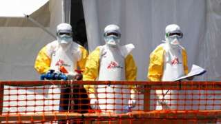 Health workers dressed in protective suits at an Ebola treatment centre in DR Congo