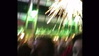 Firework exploding above crowd
