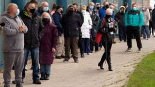 Queue of people outside Merthyr Tydfil Leisure Centre