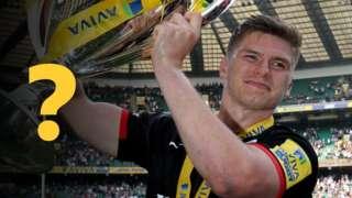 Owen Farrell holds the Premiership trophy