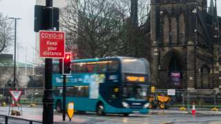 A bus travels past St Thomas' Church in Newcastle city centre