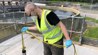 Man at sewage plant
