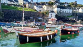 Boats on water in the village of Coverack in Cornwall