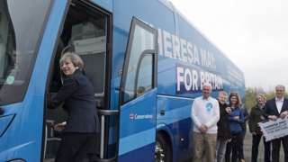 Theresa May boards her party's battlebus in Newcastle