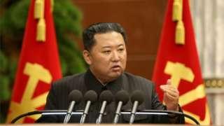 """North Korean leader Kim Jong Un speaks during the third enlarged meeting of the political bureau of the 8th Central Committee of the Workers"""" Party of Korea"""