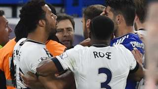 Danny Rose involved in a melee with Mousa Dembele (left) and Diego Costa (right)
