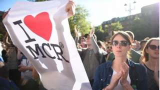 People holding up I Love MCR sign