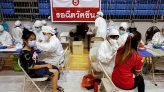 Women receive the Sinovac coronavirus disease (COVID-19) vaccine as the Thai resort island of Phuket rushes to vaccinate its population amid the COVID-19 outbreak ahead of a July 1 end of strict quarantine for overseas visitors to bring back tourism revenue, in Phuket