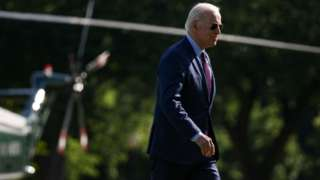 President Joe Biden walks on the Ellipse after stepping off Marine One near the White House