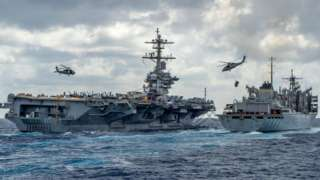 Handout picture released by the US Navy on 8 May 2019 shows the Nimitz-class aircraft carrier USS Abraham Lincoln being replenished at sea by the fast combat support ship USNS Arctic (T-AOE 9)
