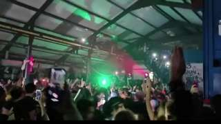 Hundreds of people are dancing and filming themselves on their phones in a warehouse in Yate.