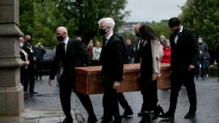 The coffin of John Hume is brought into St Eugene's Cathedral in Londonderry