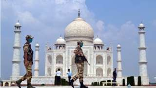 Indian security personnel stand guard at the Taj Mahal in Agra, Uttar Pradesh, India, 21 September 2020