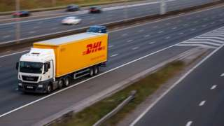 DHL lorry in motion on the motorway - stock photo
