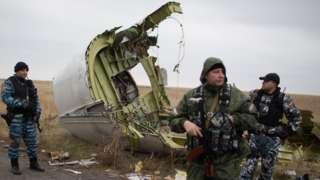 MH17 debris and pro-Russian militia standing guard, 11 Nov 14