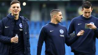 Brighton players arrive
