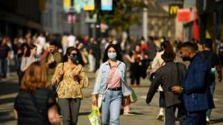 Library image of shoppers in Newcastle city centre wearing face masks