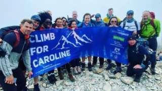 The Climb For Caroline team at the top of a peak