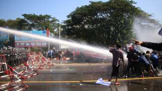 Protest in Nay Pyi Taw, 9 Feb - water cannon being fired at protesters