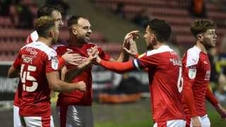 Swindon celebrate Brett Pitman's winner