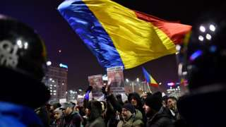 Romanians demonstrate against controversial decrees to pardon corrupt politicians and decriminalise other offenses in front of the government headquarters in Bucharest, on February 1, 2017