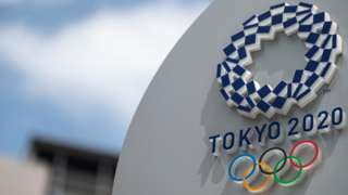 A sign with the logo of the Tokyo 2020 Olympics