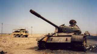 Burnt-out tank in Basra, Iraq, in 2003