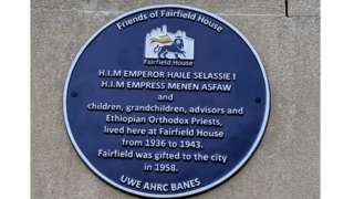 Blue plaque on the wall at Fairfield House in Bath