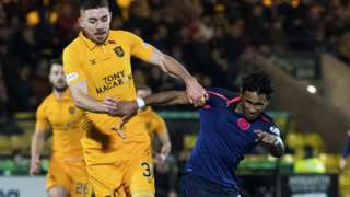 Hearts' Demetri Mitchell (R) in action with Livingston's Declan Gallagher.
