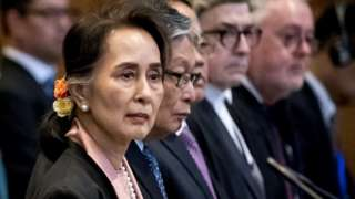 """Myanmar""""s State Counsellor Aung San Suu Kyi stands before UN""""s International Court of Justice on December 10, 2019 in in the Peace Palace of The Hague, at the start of a three-day hearing on Rohingya genocide case"""