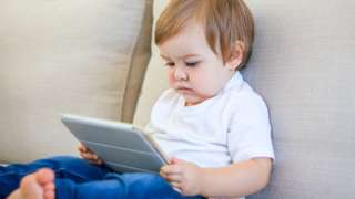 Boy using a screen
