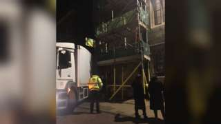 Lorry stuck on scaffolding