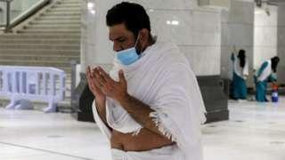 One Muslim pilgrim dey prays for di Grand Mosque for di holy city of Mecca, Saudi Arabia