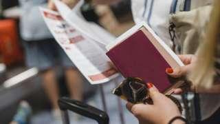 Woman holds passport