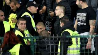 Stewards appeared to join those chanting racist abuse