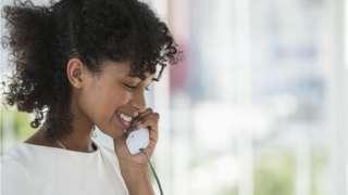 young woman on landline phone