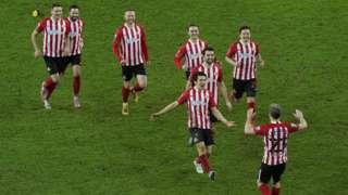 Sunderland players celebrate penalty win