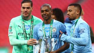 Manchester City's Ederson, Fernandinho and Gabriel Jesus with the EFL Cup