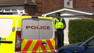 Police outside scene of the crime on Sandmere Road