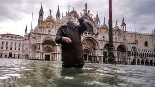 Woman in flooded Venice