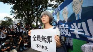 An activist protests outside the Tokyo District Court in Tokyo, Japan, 19 September 2019