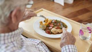 Elderly man eating