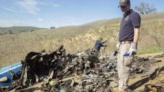 Investigators work at the scene of the helicopter crash that killed former NBA star Kobe Bryant
