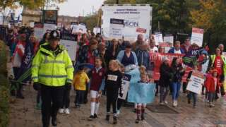 Campaigners march to protest the planned closure of units at South Tyneside Hospital