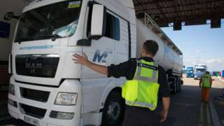 A lorry is stopped by Border Force staff at Portsmouth port