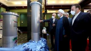 Iranian President Hassan Rouhani (2nd left) is shown nuclear technology in Tehran on 10 April 2021